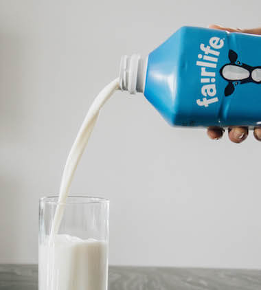 Milk being pour into glass